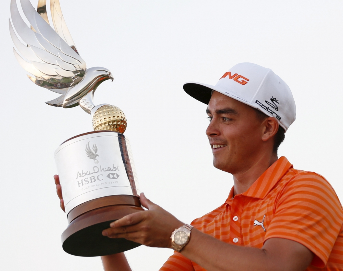 Rickie Fowler holds his trophy