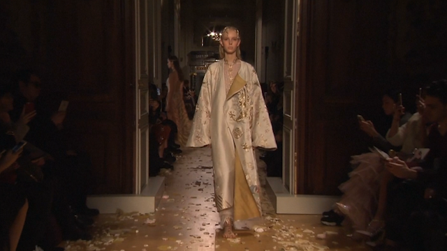 Model walks for Valentino
