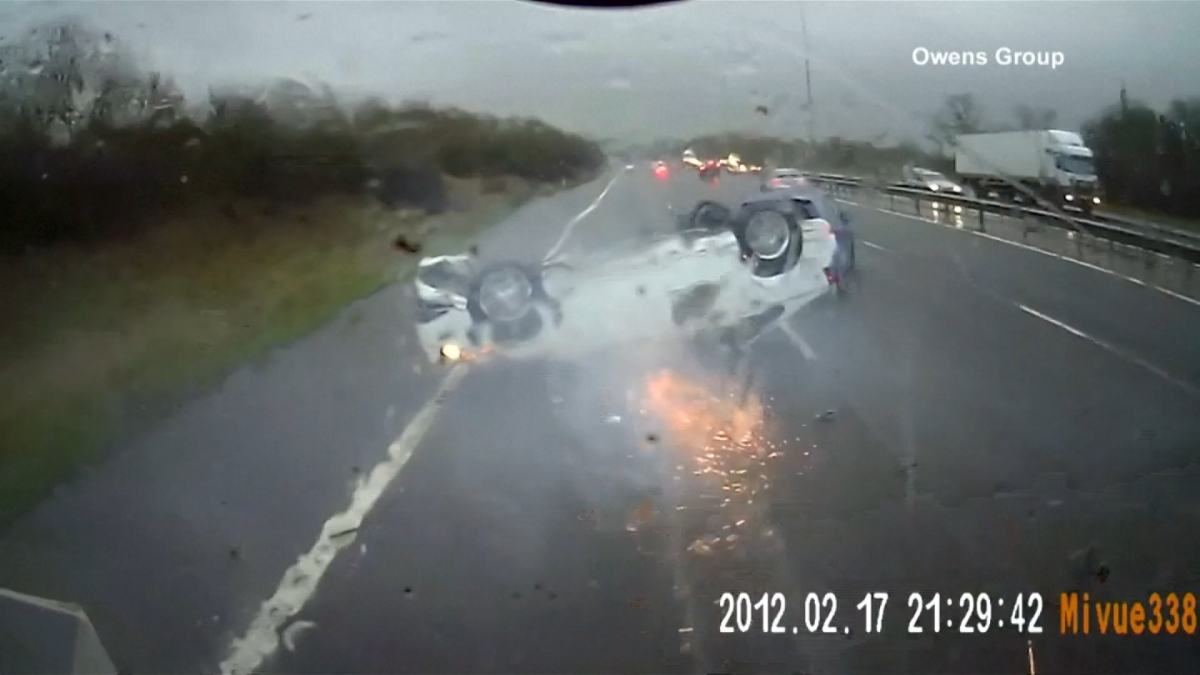 Video: Car on fire skids upside down across UK motorway
