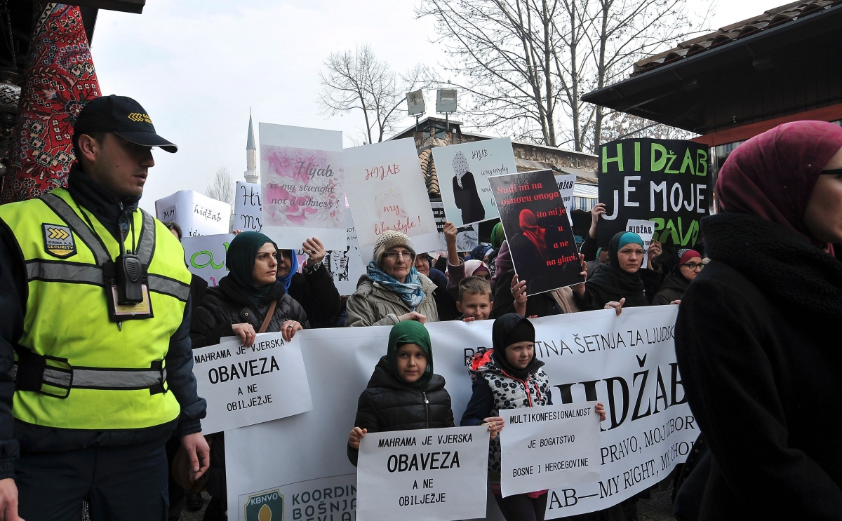Muslim women take part in a protest