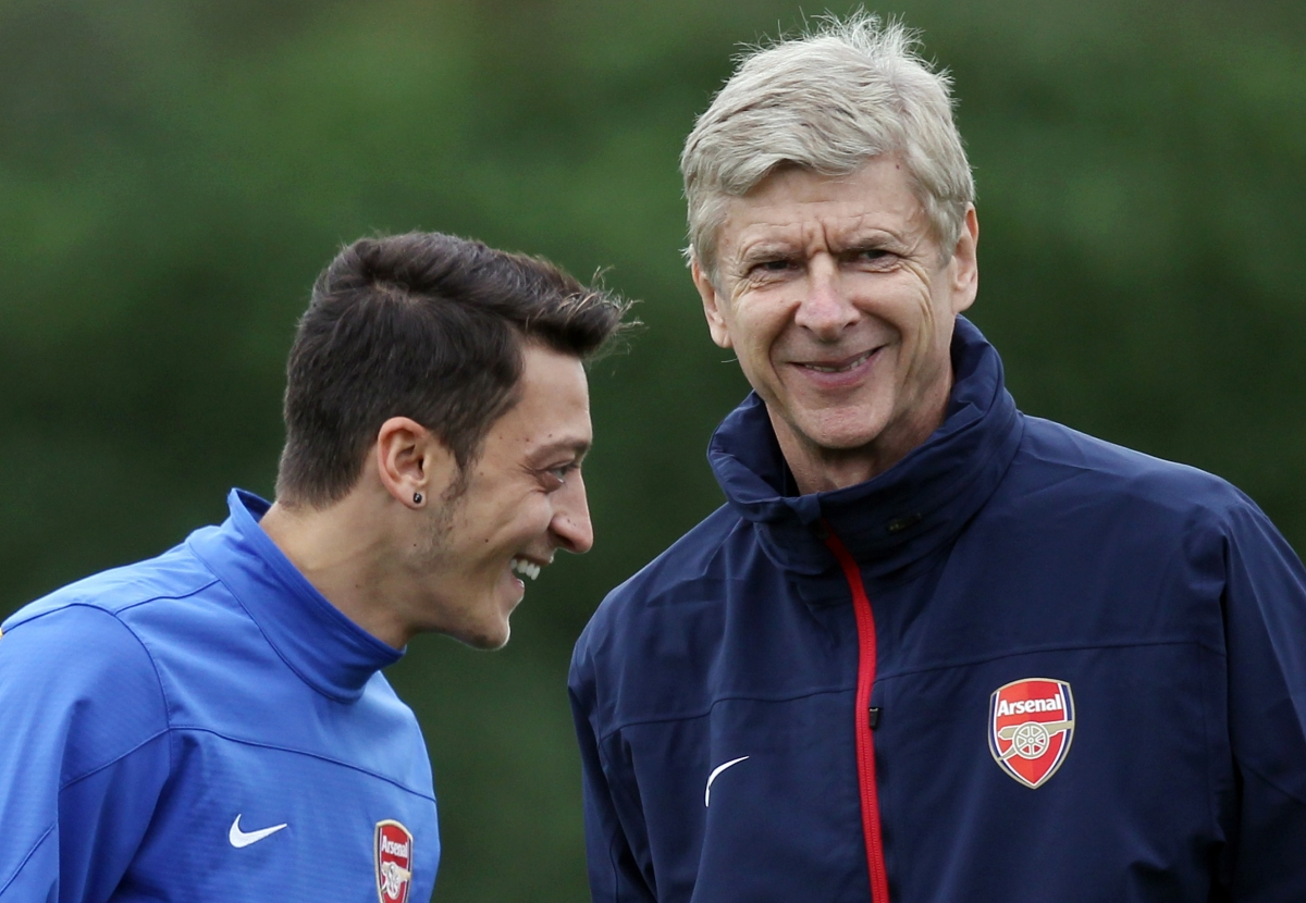 Arsenal's Mesut Ozil and Arsene Wenger