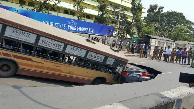 massive sinkhole swallows bus and car in india u0026 39 s chennai