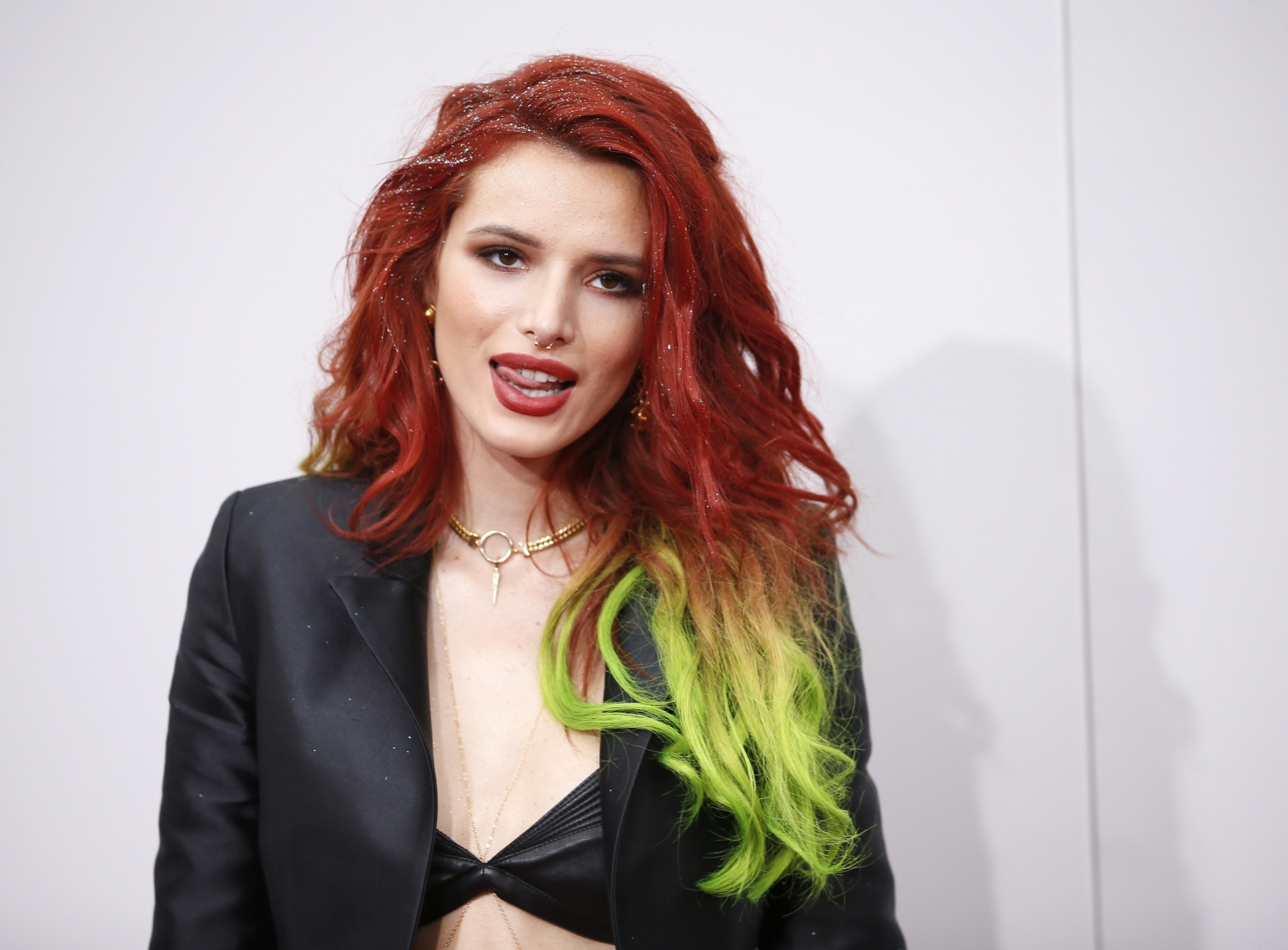 Bella Thorne goes naked and bites her thumb in sexy bathtub photo