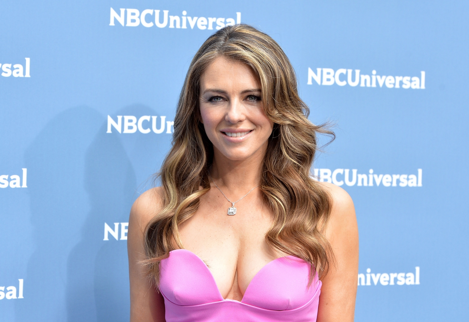 Elizabeth Hurley and David Foster are 'dating': Couple shared 'private flirty moments together'