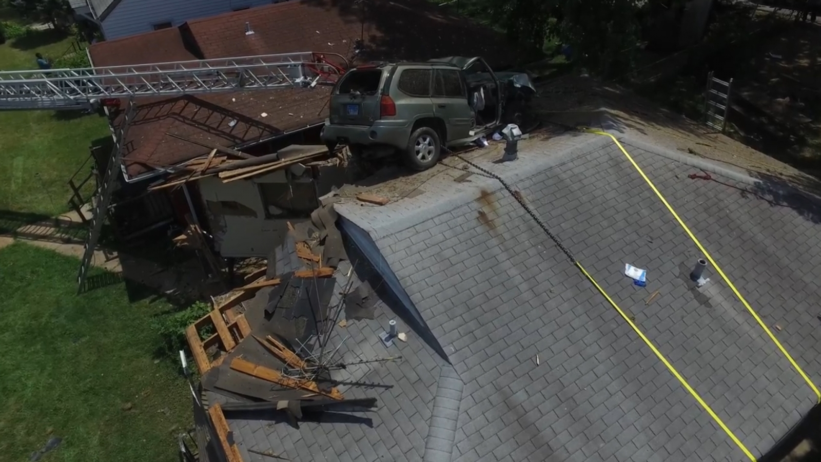 Car Crashes Into Roof Of House
