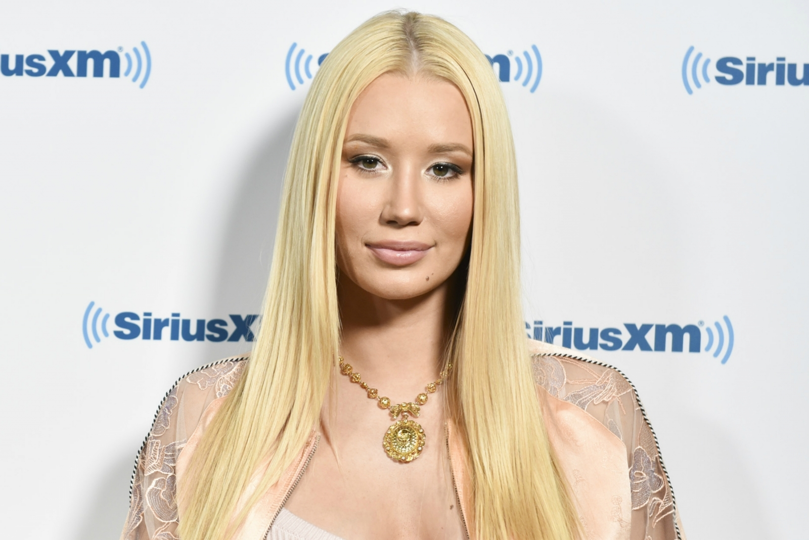Topless Iggy Azalea barely covers her breasts in racy Instagram selfies: 'Getting awfully desperate'