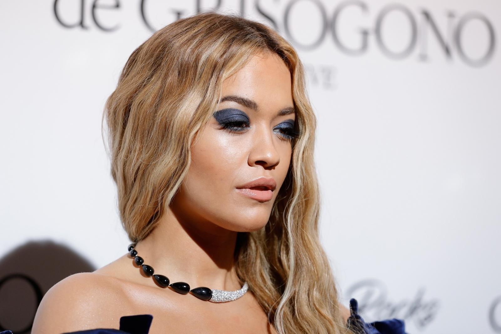 Rita Ora suffers major wardrobe malfunction in risque cleavage-baring coat