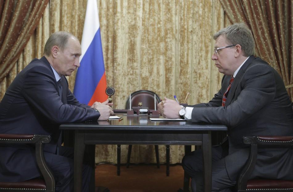Prime minister vladimir putin l meets finance minister alexei kudrin