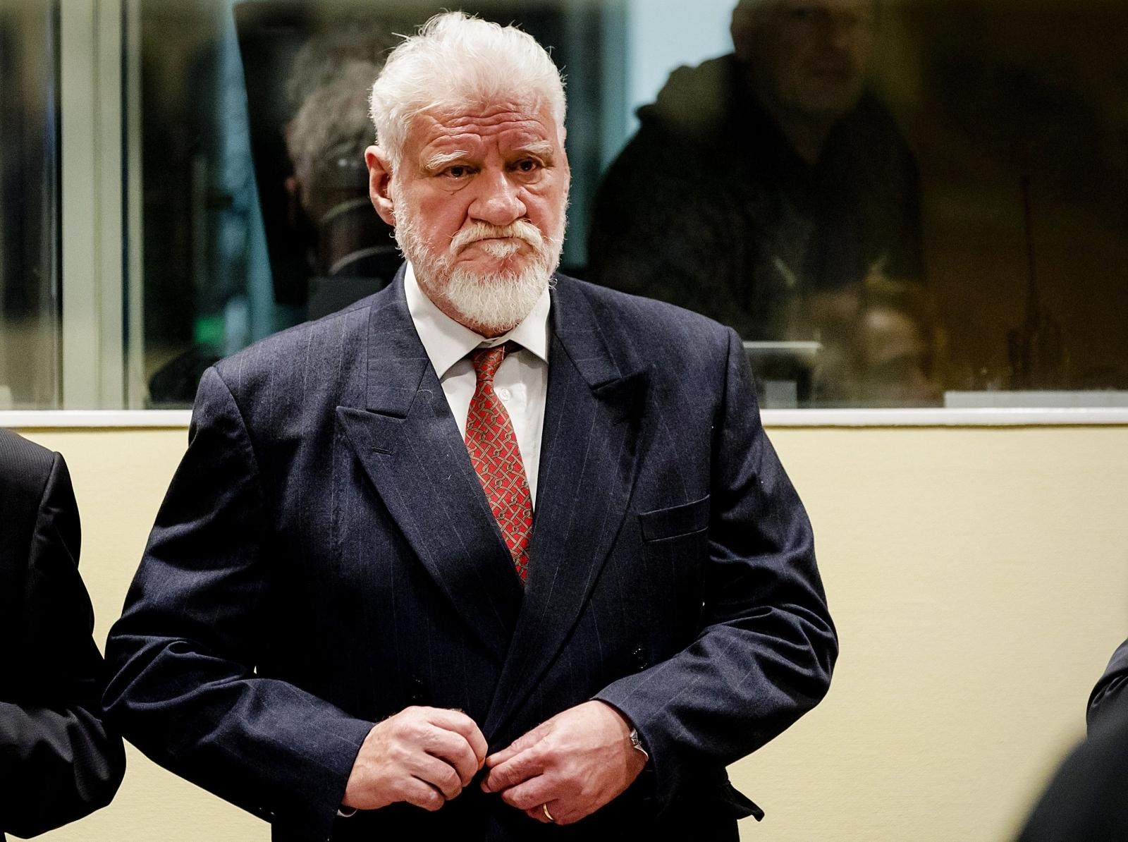 Slobodan Praljak Video >> War criminal 'drinks poison' during Hague tribunal sentence appeal