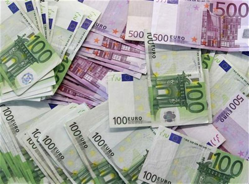 Euro notes are spread out at a bank branch in Madrid