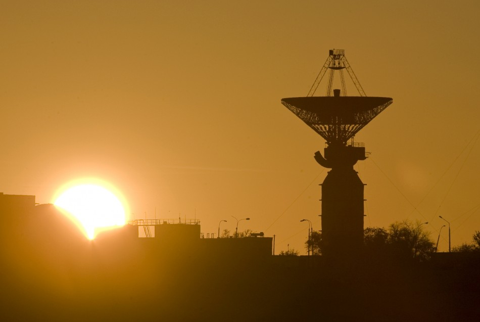 An antenna for space communication is seen at sunrise at Baik