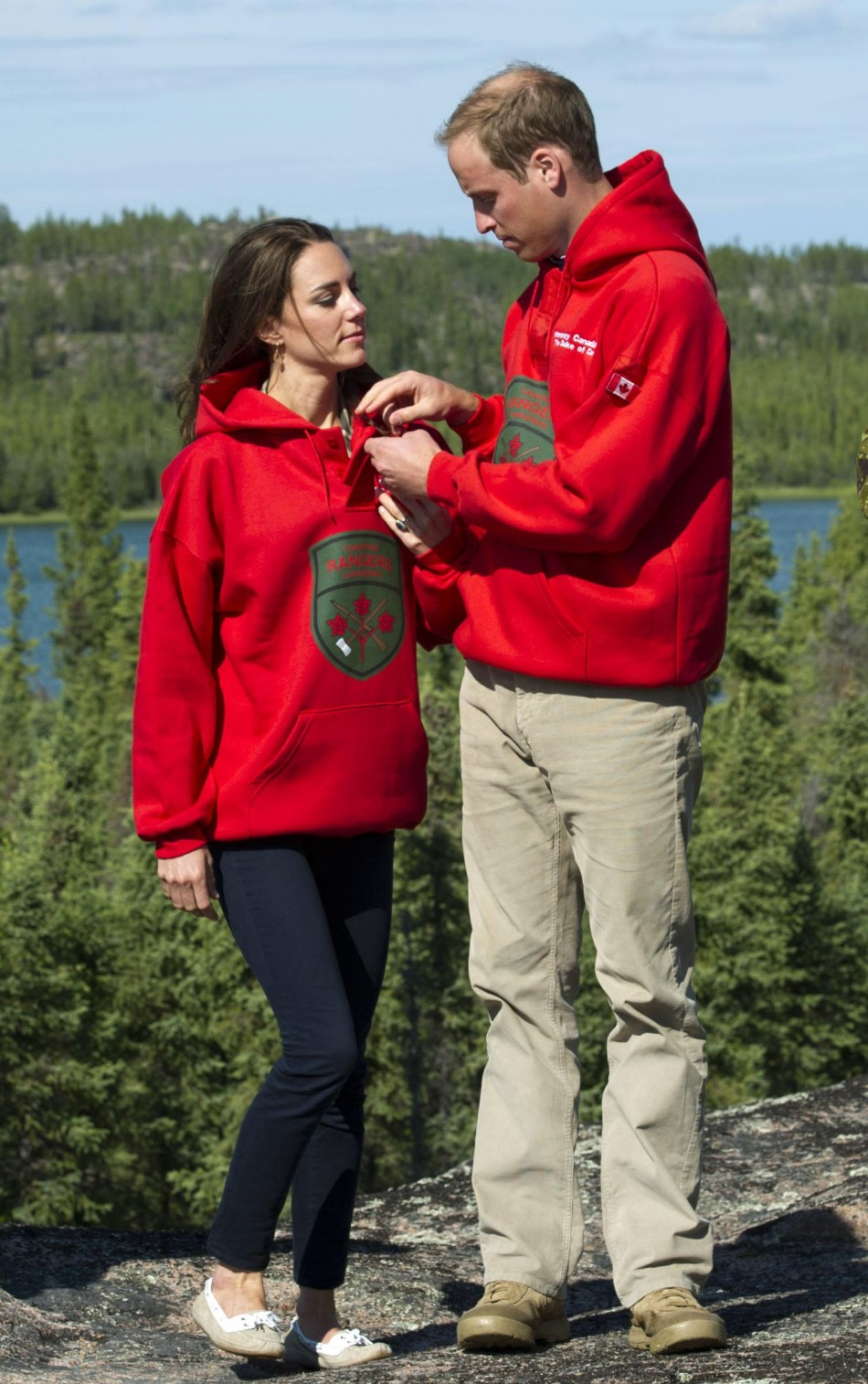 Britain's Prince William and his wife Catherine, Duchess of Cambridge, wear sweaters of the Canadian Rangers during a visit to Blatchford Lake, Northwest Territories