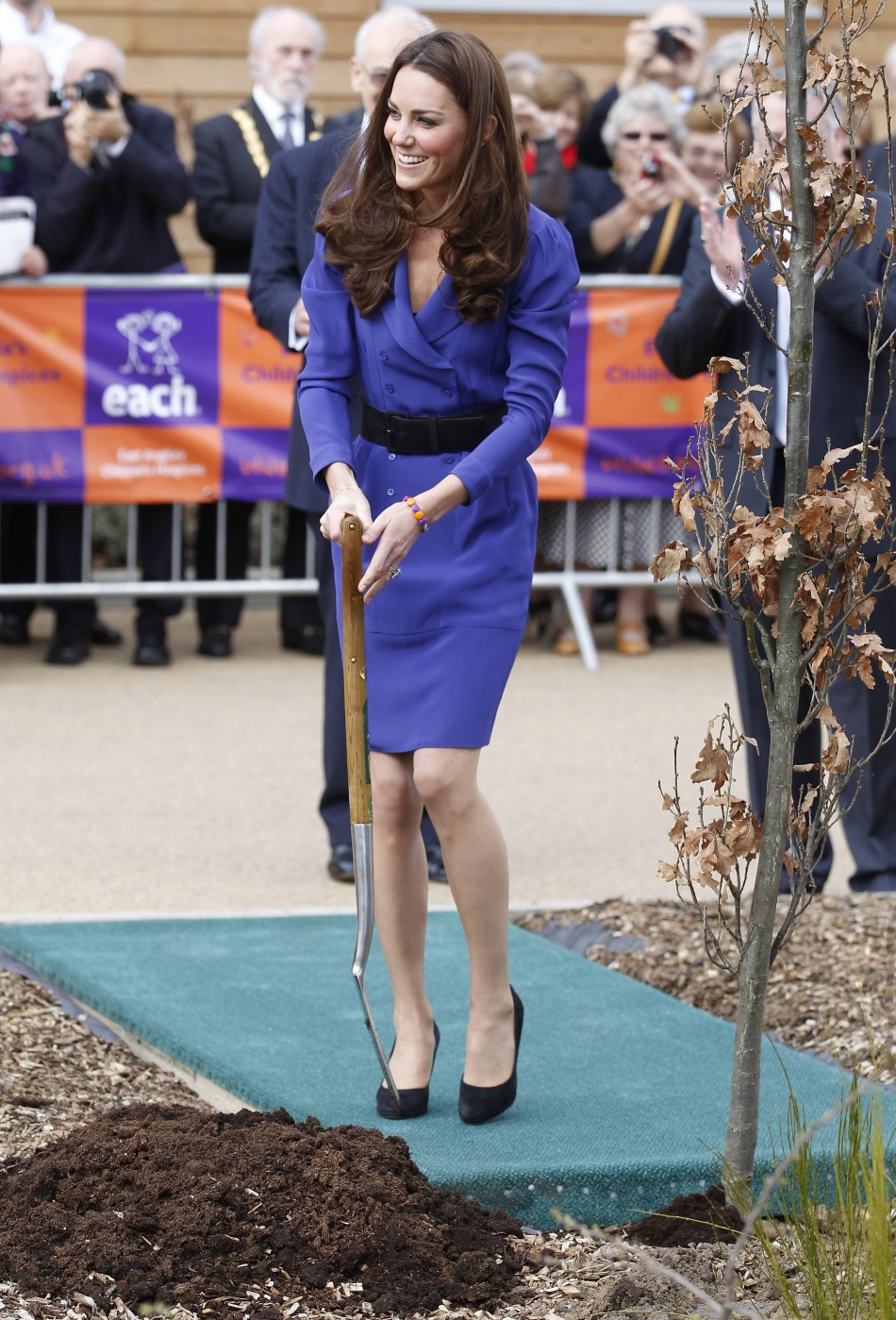 Britain's Catherine, Duchess of Cambridge plants a tree after opening a children's hospice in Ipswich
