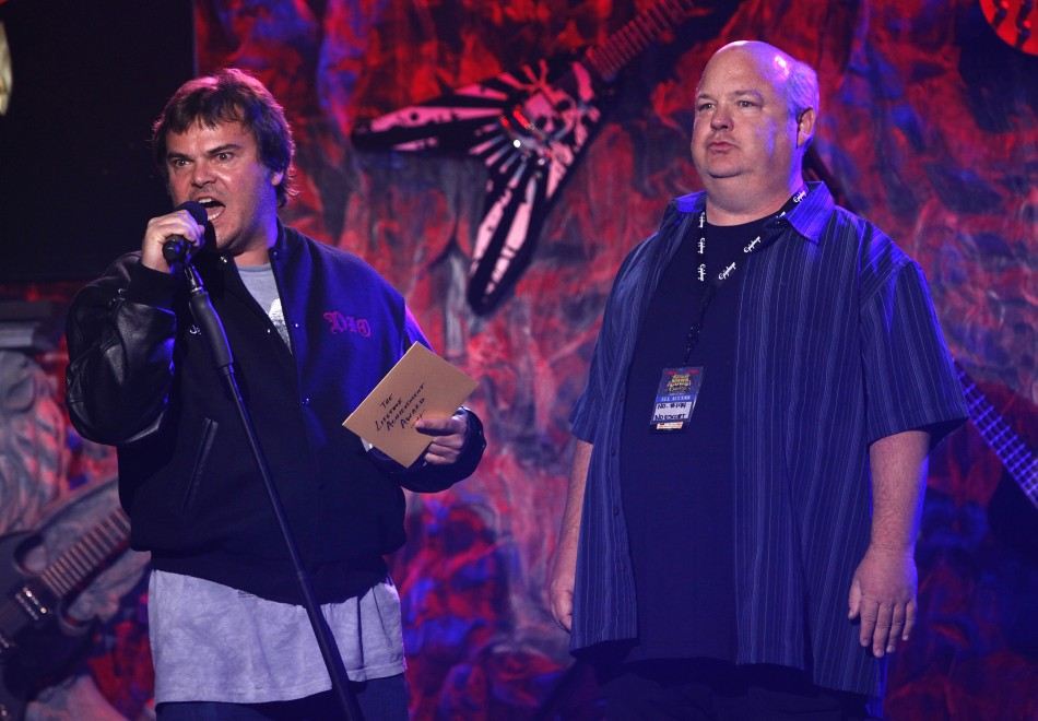 Members of American rock band Tenacious D Jack Black (L) and Kyle Gass speak on stage at the fourth annual Golden Gods awards at Nokia theatre in Los Angeles