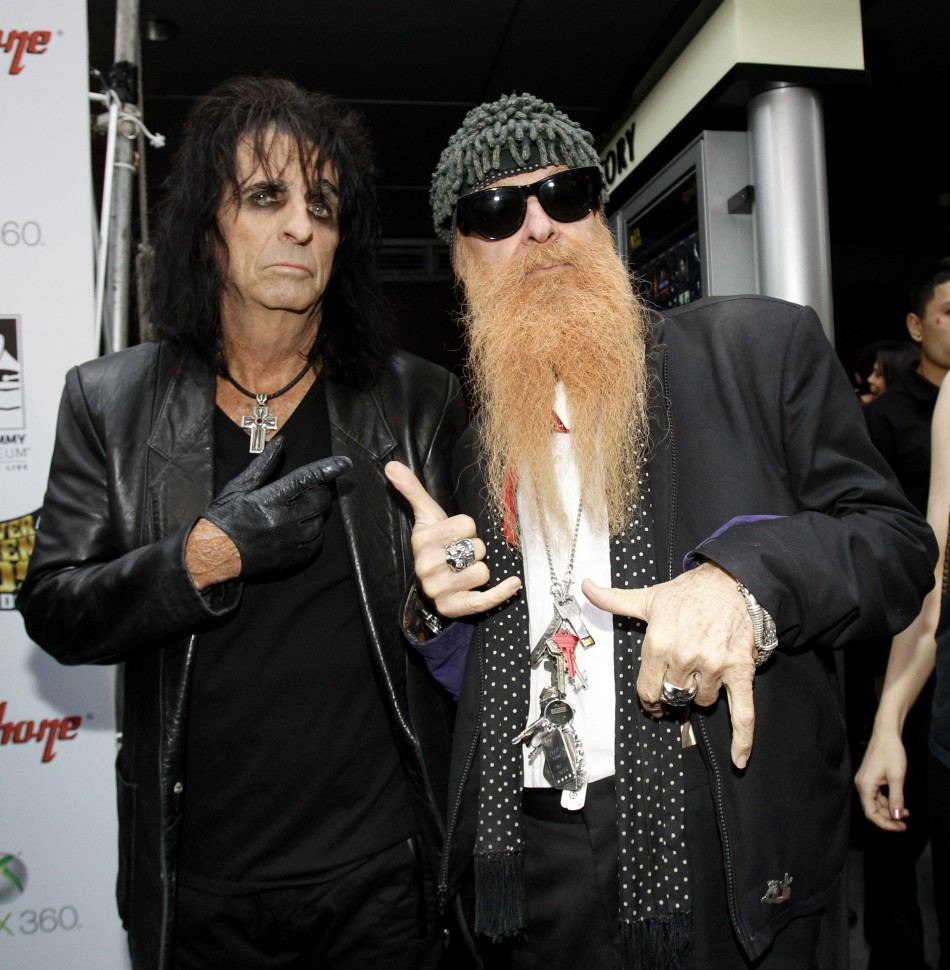Musicians Alice Cooper (L) and Billy Gibbons pose as they arrive at the fourth annual Golden Gods awards at Nokia theatre in Los Angeles