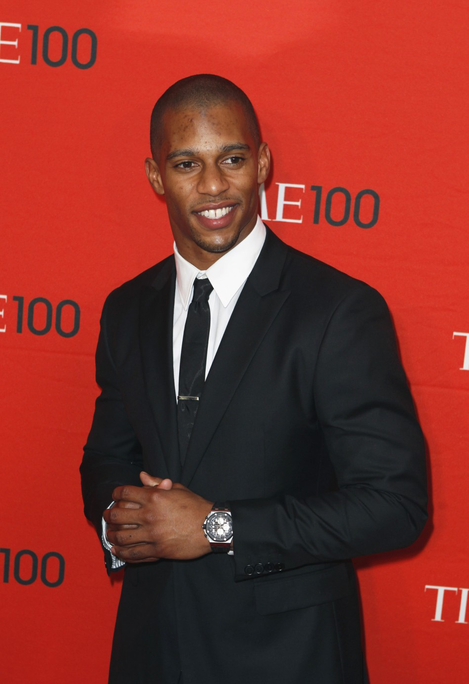 Football player Victor Cruz arrives to be honored at the Time 100 Gala in New York