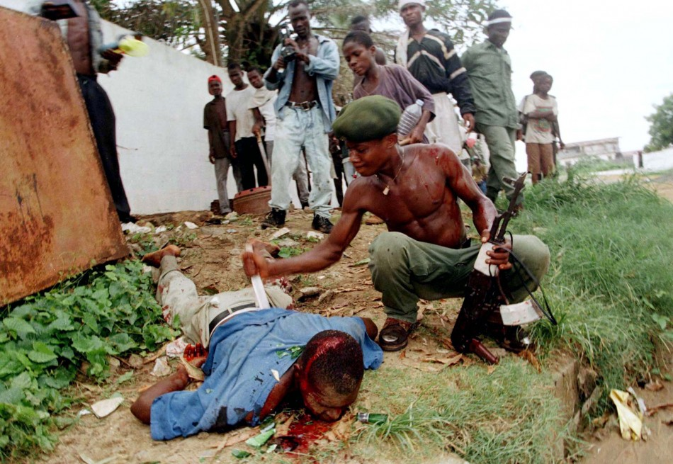 Liberian lies wounded after being stabbed by rebel fighting for samuel