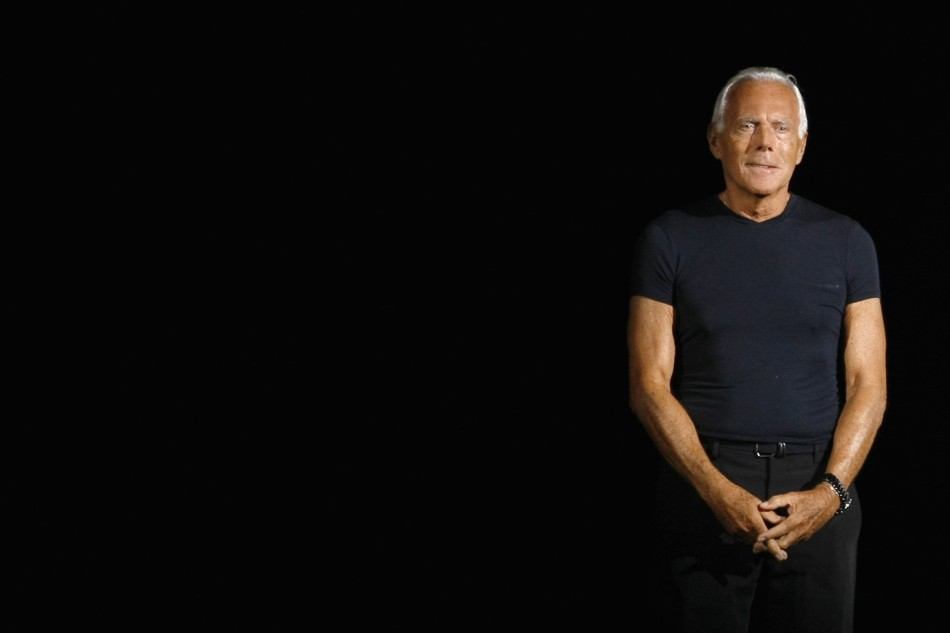 6. Italian designer Giorgio Armani acknowledges the applause at the end of his Spring/Summer 2012 women's collection during Milan Fashion Week