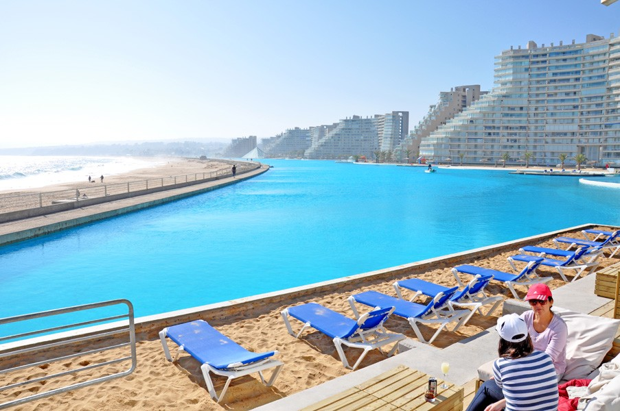 World s largest pool in chile wows tourists with caribbean blue sea experience photos for The worlds biggest swimming pool