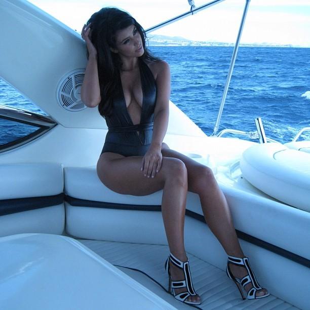 Kim Kardashian Flashes Bra; Tweets Raunchy Swimsuit Photo