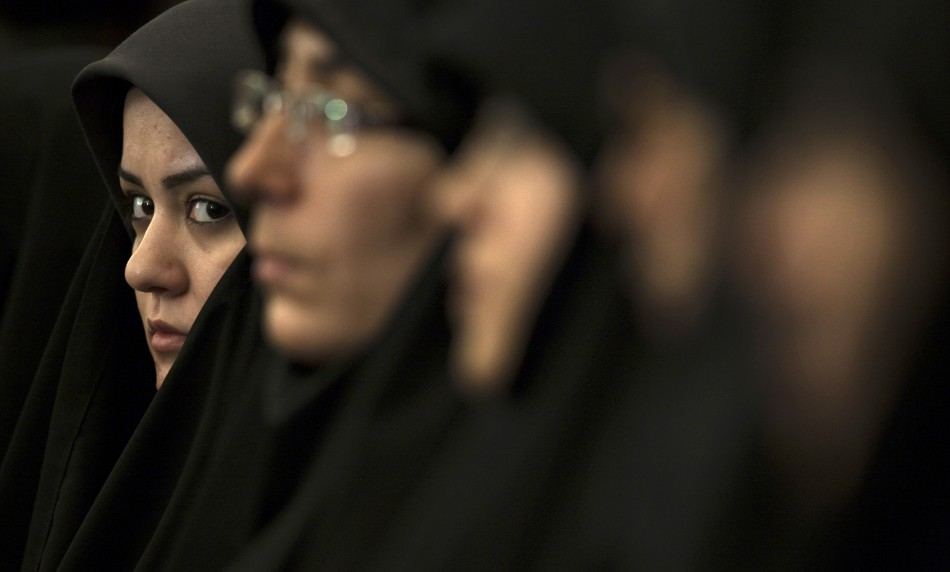 A religious activist looks on while attending the 25th International Islamic Unity Conference in Tehran