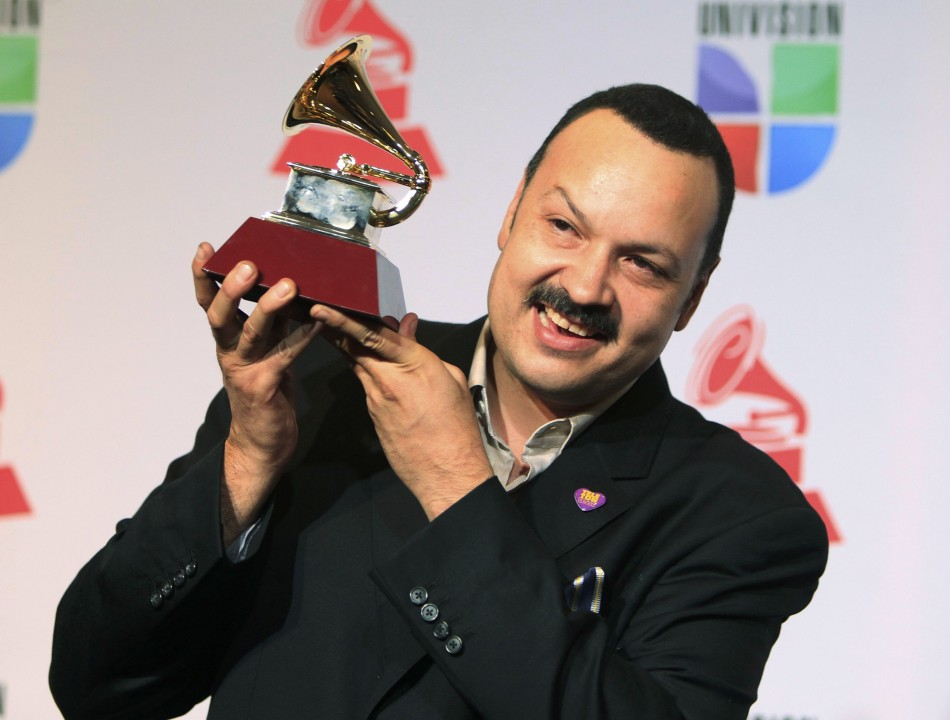 Aguilar poses with award for best ranchero album for