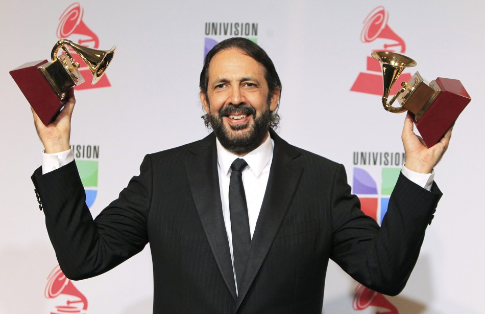 Guerra holds his awards for producer of the year and album of the year for