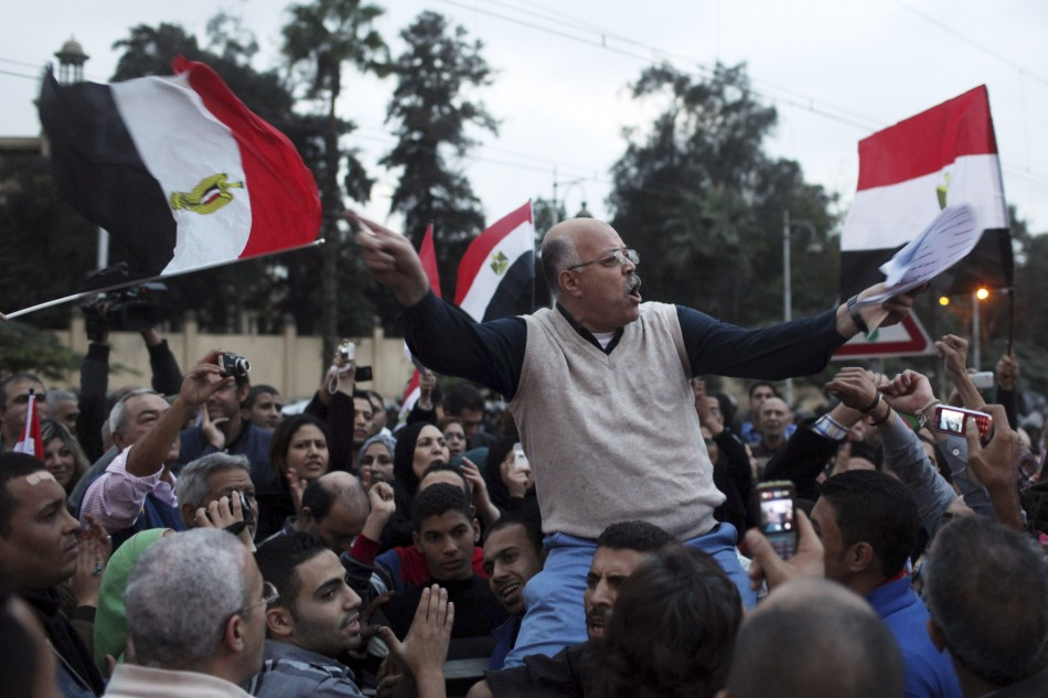 A protester chants anti-Mursi slogans in front of the presidential palace in Cairo