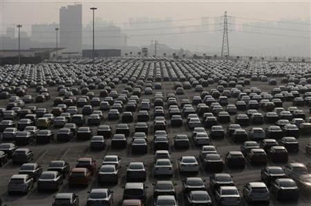 New cars are seen at a parking lot of Changan Ford