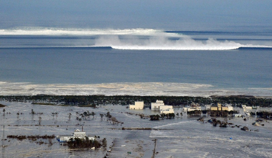 An oncoming tsunami strikes the coast in Natori City, Miyagi Prefecture