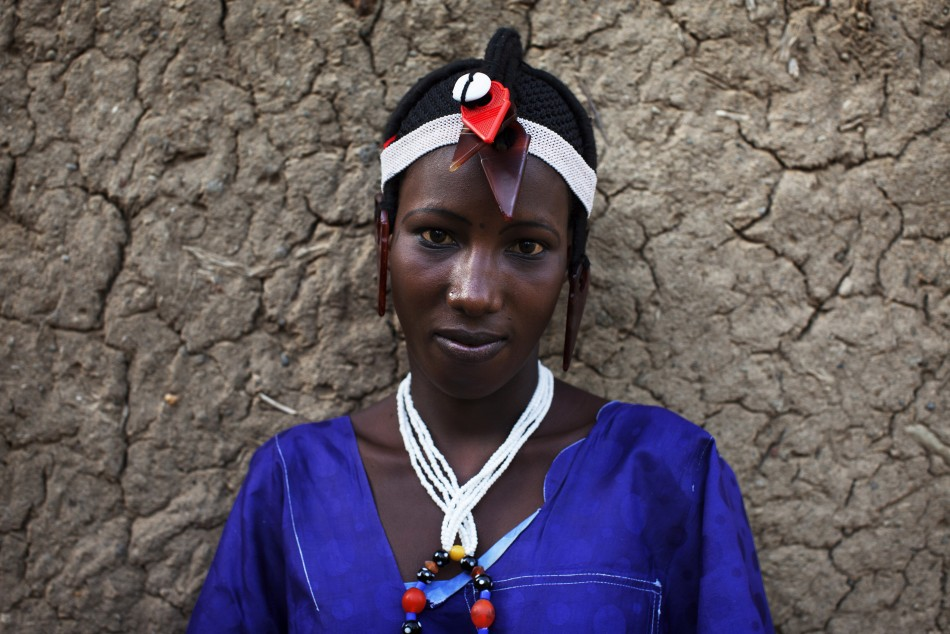Fatoumata Toure, 15, wears a traditional Songhai headdress made by artisan Hally Bara in Gao, Mali, March 6, 2013