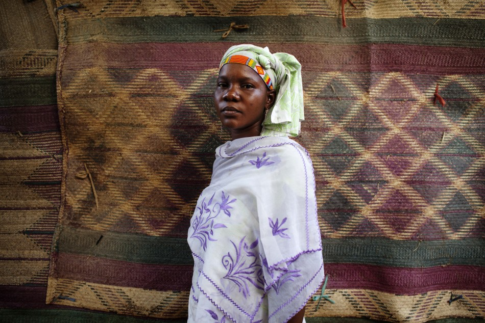 Fady Diarra, 25, wears a traditional Songhai beaded head wrap in Gao, Mali, March 6, 2013.