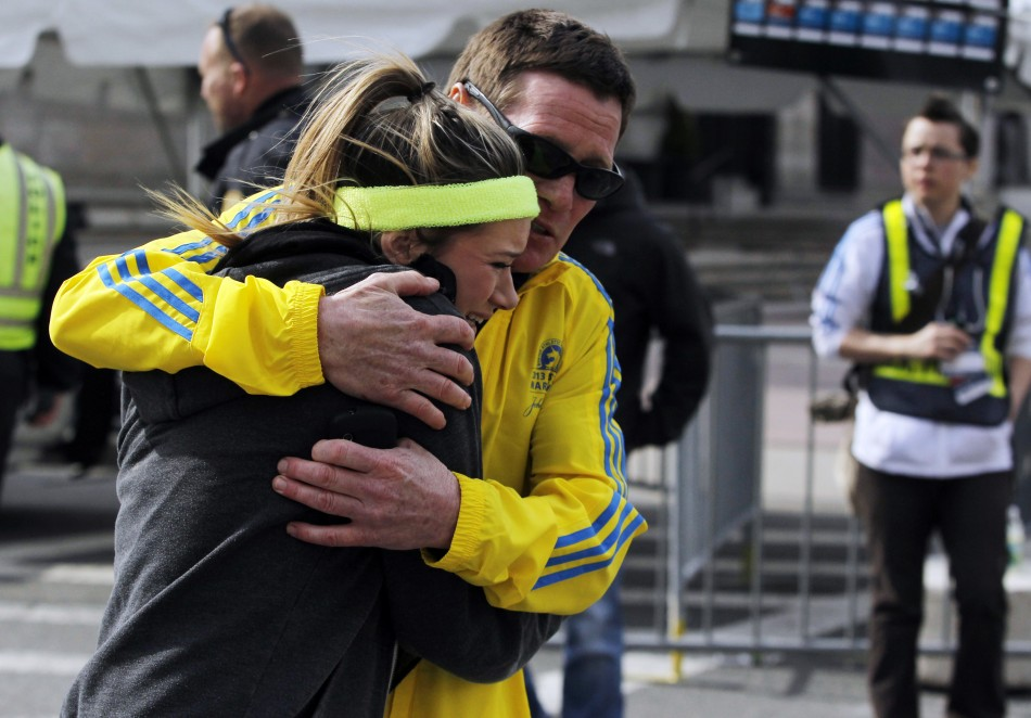 Man Comforting Woman Boston Marathon a Woman is Comforted by a Man