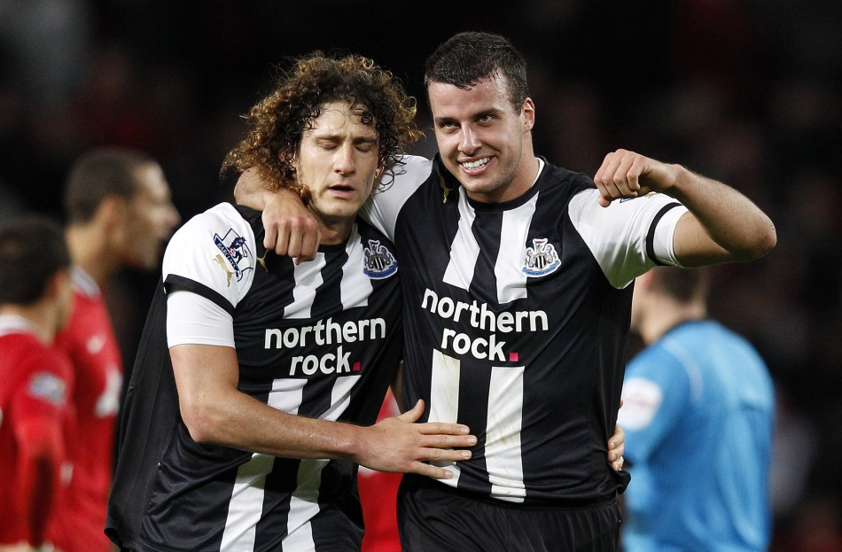 Fabricio Coloccini and Steven Taylor (L)
