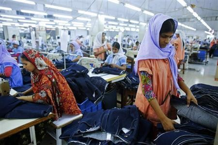 Workers sort clothes at a garment factory near the collapsed Rana Plaza building in Savar, Bangladesh June 16, 2013.