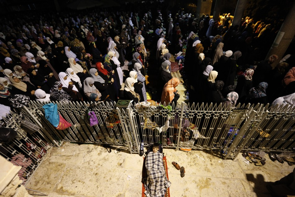 Female Palestinian Muslims pray in front of the Dome of the Rock, in the Al Aqsa Mosque compound in Jerusalem early August 4, 2013, during Lailat-Al-Qadr. (Photo: Reuters)