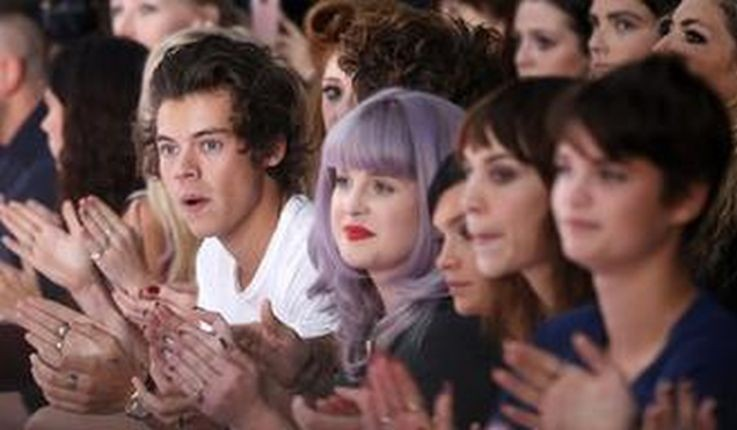 Harry Styles of the band One Direction (L), actress Kelly Osbourne (2nd L), model Leigh Lazark (C), television presenter Alexa Chung (2nd R) and model Pixie Geldof. (Reuters)