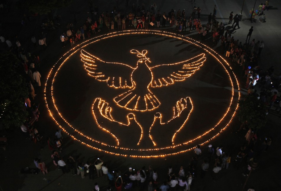 People light lamps as they make a formation of a peace symbol on the eve of Diwali in Chandigarh, India. (Photo: Reuters)