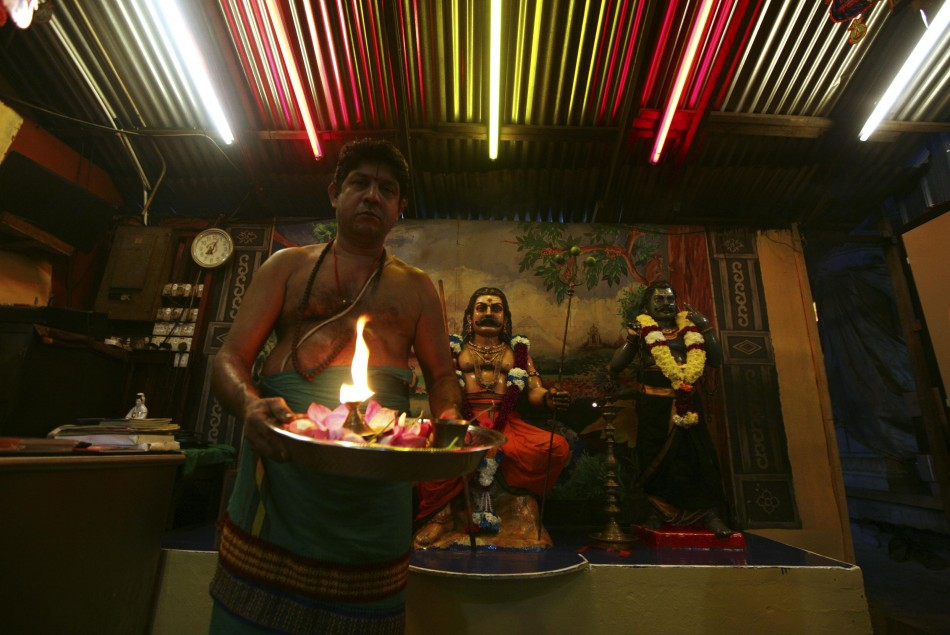 A Hindu priest holds an oil lamp after Diwali prayers inside a Hindu temple in Kuala Lumpur. (Photo: Reuters)