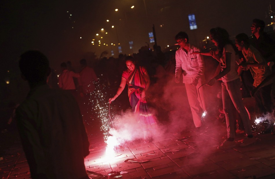 People burn crackers to celebrate Diwali in Mumbai. (Photo: Reuters)