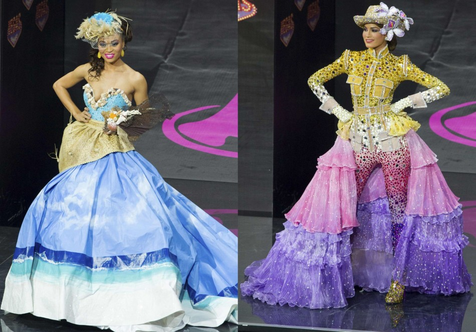 Snwazna Adams, Miss Turks & Caicos (L) and Gabriela Isler, Miss Venezuela, model in the national costume contest. (Photo: Reuters)