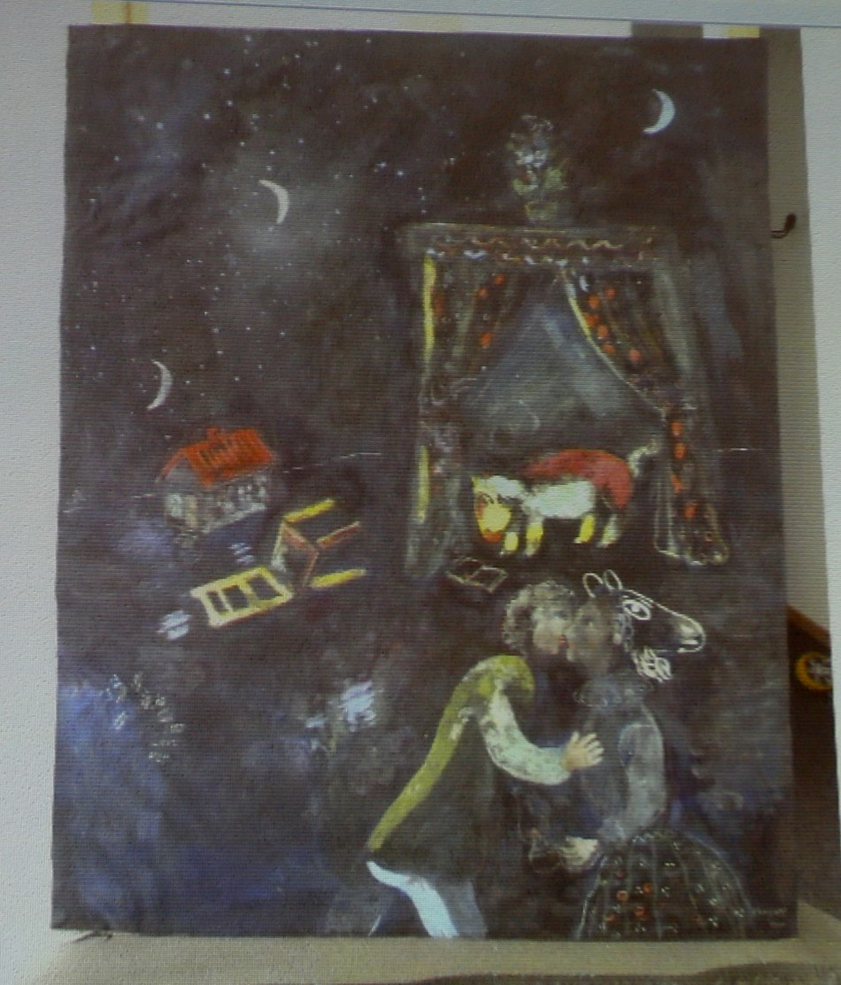 A formerly unknown painting of French artist Marc Chagall is beamed to a wall November 5, 2013, at an Augsburg courtroom during a news conference of state prosecutor Reinhard Nemetz and expert art historian Meike Hoffmann from the Berlin Free University. A Jewish group accused Germany on Monday of moral complicity in concealment of stolen paintings after it emerged authorities failed for two years to report discovery of a trove of modern art seized by the Nazis, including works by Picasso and Matisse. Customs officials' chance discovery of 1,500 artworks in a Munich flat owned by Cornelius Gurlitt, the reclusive elderly son of war-time art dealer Hildebrand Gurlitt, who was authorized by Hitler's propagandist minister Joseph Goebbels to sell art the Nazis stole, was revealed in a report by news magazine Focus over the weekend. The art works missing for more than 70 years could be worth well over one billion euros. REUTERS/Michael Dalder