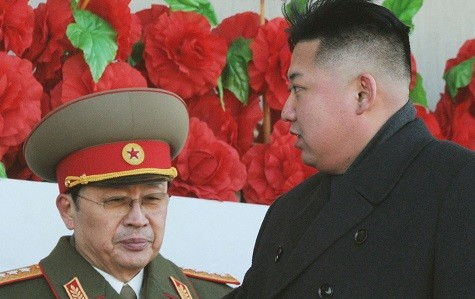 North Korean leader Kim Jong-un (R), flanked by his uncle Jang Song-thaek (Reuters)