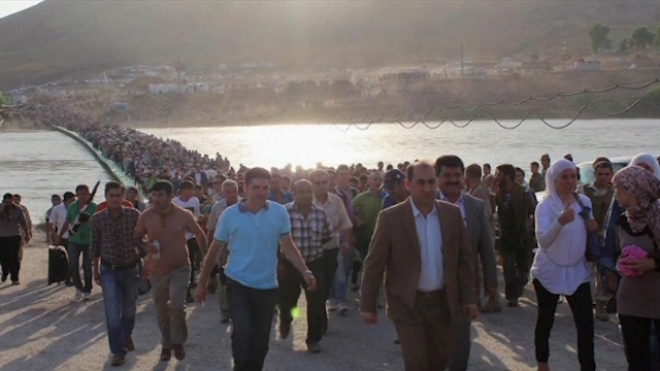 Thousands Of Syrians Seek Refuge In Northern Iraq