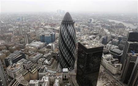 The Swiss RE building, known as the Gherkin, is pictured from a