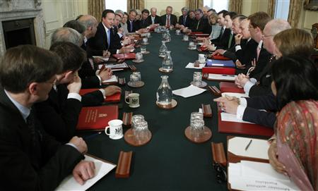 Prime Minister David Cameron leads his first cabinet meeting at number 10 Downing Street in London