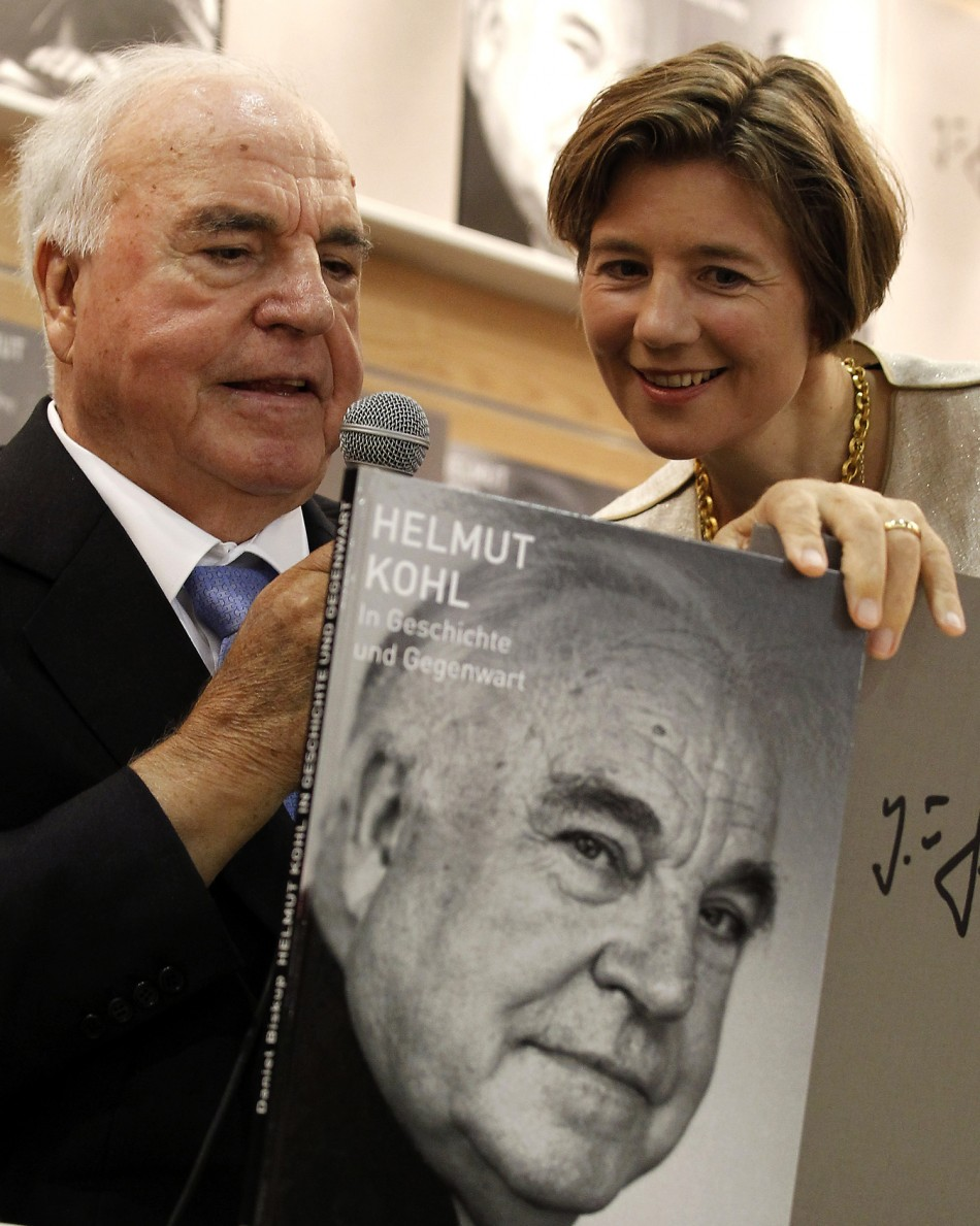 Former German Chancellor Helmut Kohl listens to his wife Maike Kohl-Richter during a presentation of a photo book about his life at the book fair in Frankfurt