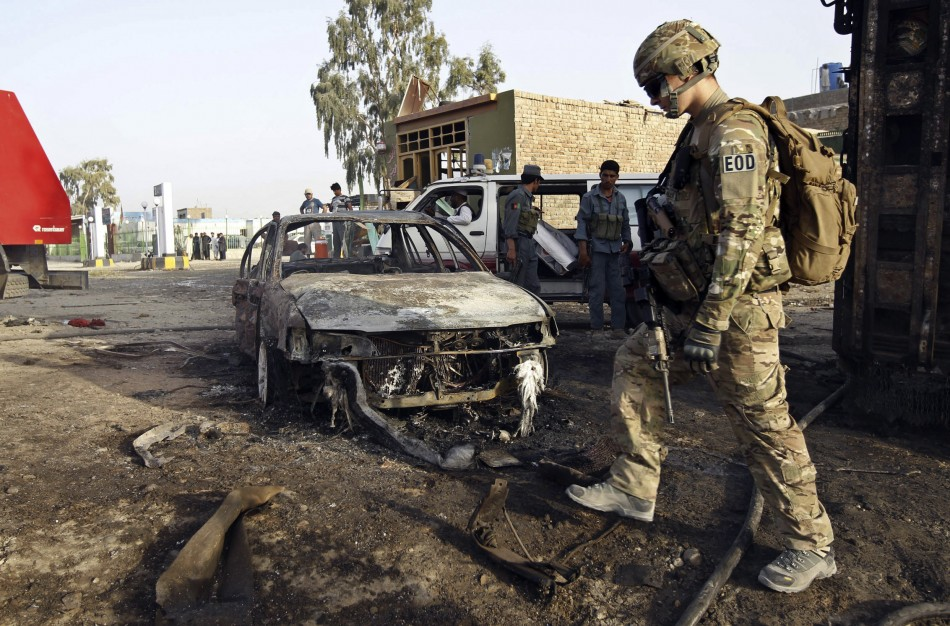 A U.S. soldier walks at the site of suicide attack in Jalalabad