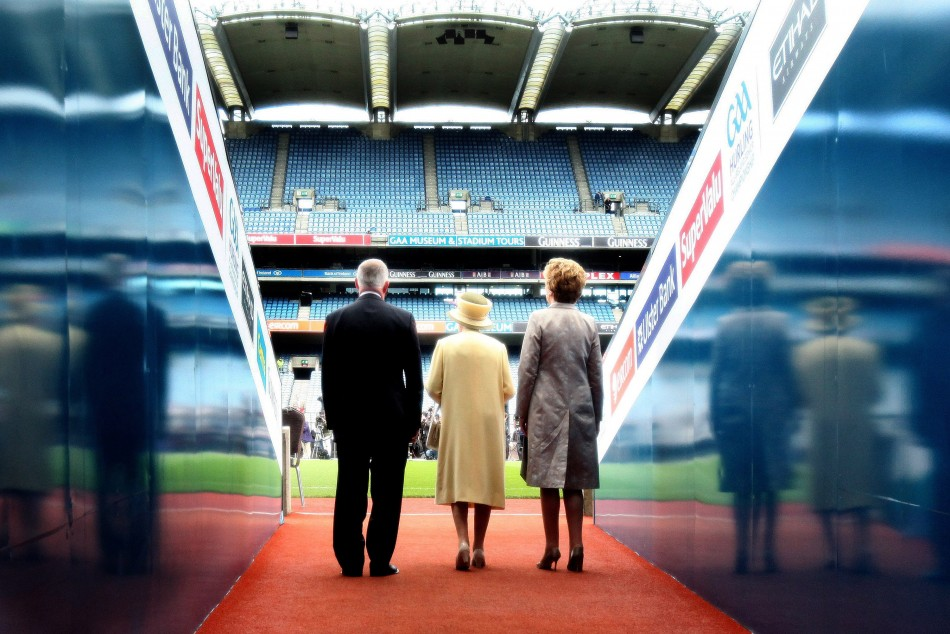 The Queen enters Croke Park stadium with Ireland039s President Mary McAleese and Gaelic Athletic Association President Christy Cooney.