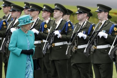 The Queen inspects a Guard of Honour at the residence of the Irish President in Dublin.